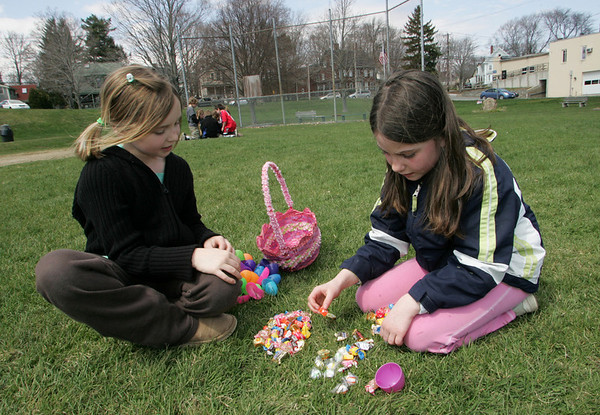 Essex: Elizabet Hull, 9, left, and Courtney Doane, 9, sort through the candy they got after the Easter egg hunt at Memorial Field Saturday afternoon.  The egg hunt was rescheduled from last weekend due to weather.  Mary Muckenhoupt/Gloucester Daily Times