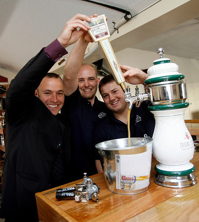 Essex: Noah Goldstein, left, Brad Atkinson, center, and Ryan Cox, right, pull their first tap in their restaurant The Farm Bar & Grille in Essex. Photo by Kate Glass/Gloucester Daily Times Tuesday, April 14, 2009