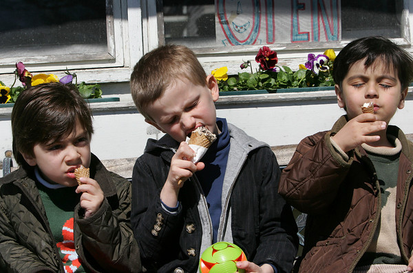 Manchester: From left, Alex Samiei, 6, Eli Heanue, 5, and Max Samiei, enjoy ice cream cones in front of Captain Dusty's Ice Cream while enjoying the nice weather Wednesday afternoon. Temperatues will climb into the mid 50s today before reaching 70 degrees Friday. Mary Muckenhoupt/Gloucester Daily Times