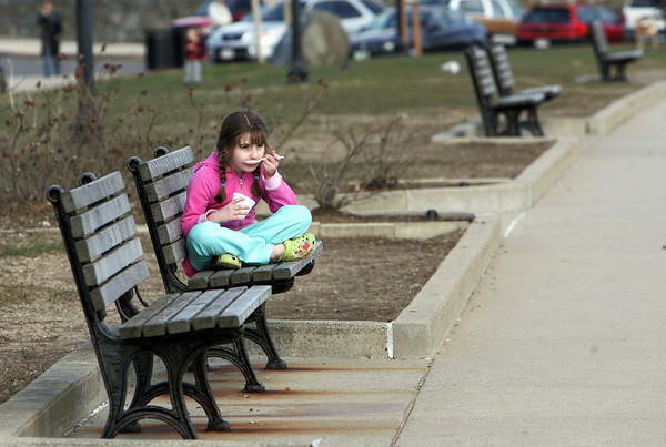Gloucester: Isabella Militello, 6, of Gloucester looks out at Gloucester Harbor while eating an ice-cream on Stacy Boulevard Thursday afternoon. Mary Muckenhoupt/Gloucester Daily Times