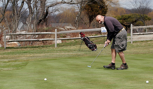 Rockport: Mike Francis of Gloucester putts on the 6th green at the Rockport Golf Club while out with Corey Hildonen of Rockport, Mike Rourke of Rowley, and Bob Antonucci of Ipswich. The group plays every Tuesday. Photo by Kate Glass/Gloucester Daily Times Tuesday, April 7, 2009