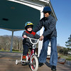 Manchester: Hunor Csenteri, 3, smiles as his mother, Emoke Csenteri, lets go of the bike just enough so he can go fast down the ramp of the bandstand at Masconomo Park yesterday afternoon. Hunor had ridden with training wheels before, but on a smaller bike, so he was still getting used to this one. Photo by Kate Glass/Gloucester Daily Times Monday, April 13, 2009