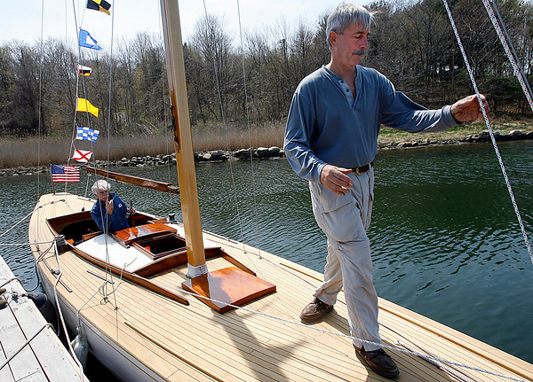 Gloucester: Graham Tutill, left, systems engineer, and Rick Trepp, owner of The Spirit, adjust the lines of the 1940s Alden class sailboat, during the boat's launch at River Boat Works at Montgomery Boat Yard yesterday afternoon. It took four years to restore the boat, which Trepp says has not been in the water for over 20 years. Photo by Kate Glass/Gloucester Daily Times Monday, April 27, 2009