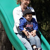 Rockport: Nina Suzette slides down with her son Joshua Chiriboga, 4, while playing at Millbrook Meadow Wednesday afternoon. Mary Muckenhoupt/Gloucester Daily Times