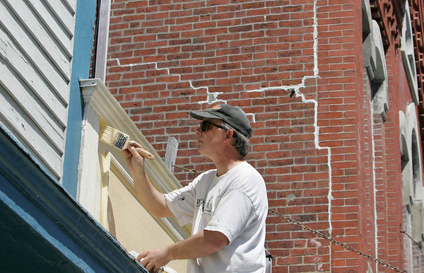 "Rockport: David Doc Vincent works on painting above The Coffee Shop on Main Street in Rockport Friday afternoon.  ""This is my day job,"" says Vincent who is also a drummer in a band. Mary Muckenhoupt/Gloucester Daily Times"