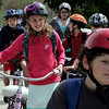 Manchester: Students, including Hayley Malloy and Petrukas West, right, walk on the pedestrian bridge over Lincoln Street with their bikes after school was released during Ride Your Bike to School Week Thursday afternoon.  With the help pf parent volunteers who help crossing guard at busy intersections over 60 percent of the students ride their bikes to and from school all week.  The classroom with the most bike riders gets an ice cream party at the end of the week and each ride to school gets the student an entry in a raffle to win a new bike.  Mary Muckenhout/Gloucester Daily Times