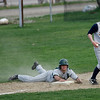 Essex: Manchester Essex's Ben Kekeisen looks up for the call after sliding into third base as Lynnfield's Mike Lang hangs onto the ball yesterday afternoon. Kekeisen was out. Photo by Kate Glass/Gloucester Daily Times Tuesday, April 28, 2009