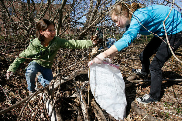 Rockport: Abby Guelli, left, and Marleigh Callahan, both members of Girl Scout Troop 440, remove trash from the woods surrounding Rockport Elementary School as part of an Earth Day Cleanup. Earth Day, which was first celebrated in 1970, is today. Photo by Kate Glass/Gloucester Daily Times Tuesday, April 15, 2009