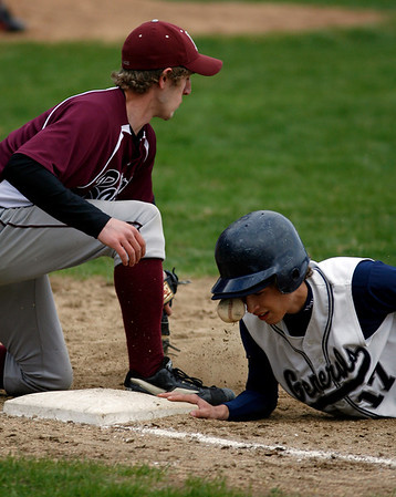 Wenham: Rockport first baseman David Campbell misses a bad bounce, which hit Hamilton-Wenham's Jared Kefekas as he dove back to the bag during the Vikings' 4-0 loss yesterday. Photo by Kate Glass/Gloucester Daily Times Thursday, April 23, 2009