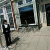 Gloucester: Maryellen Borge, co-owner of Lone Gull Coffeehouse on Main Street, has submitted a petition to remove a new bus stop, which occupies five former parking spaces in front of her business. Photo by Kate Glass/Gloucester Daily Times Monday, April 27, 2009