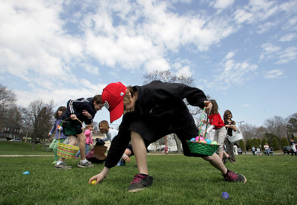 Essex: Oliver Hull, 11, grabs as many eggs as he can during the Eatser egg hunt held at Memorial Field Saturday afternoon.  The hunt, which was rescheduled from last Saturday due to weather, could not be held at it's usual location, Centennial Grove, because of the movie being filmed there. Mary Muckenhoupt/Gloucester Daily Times