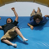 Gloucester: Zachary White, 11, left, and Andrew Widtfeldt, 11 head down an inflatable slide at Stage Fort Park before Pride Stride began Sunday afternoon.  There were plenty of great children's activities such as face painting and balloon animals to keep kids having fun before the walk. Mary Muckenhoupt/Gloucester Daily Times