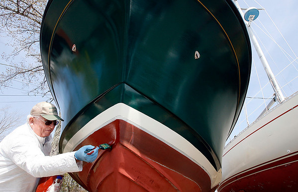 Rockport: Bob Smith paints the bottom of his boat at Granite Pier yesterday afternoon. Smith says he likes doing the work on his boat because he knows exactly how it will turn out. Photo by Kate Glass/Gloucester Daily Times Monday, April 27, 2009
