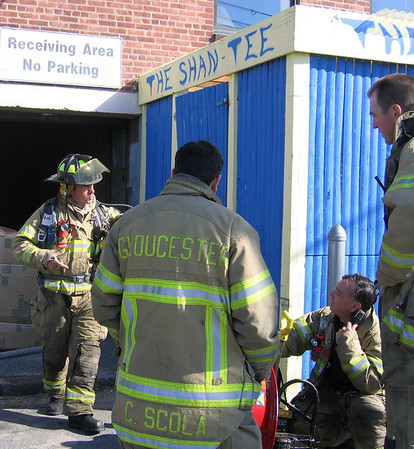 Gloucester: Gloucester Firefighters investigate the scene of a small fire in the CVS building on Main Street yesterday morning. Photo by Richard Gaines/Gloucester Daily Times Tuesday, April 28, 2009