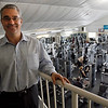 Manchester: Jay Hershon, manager of the Manchester Athletic Club, stands on a balcony overlooking their weight training area. Photo by Kate Glass/Gloucester Daily Times