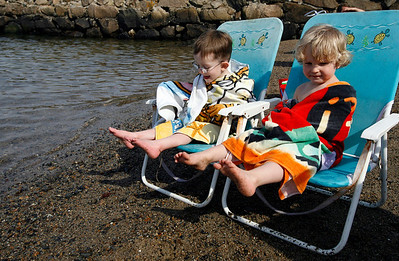 Essex: George Mullin, 3, and Joey Tofuri, 3, dry off after taking a dip at Conomo Point on Tuesday afternoon. Photo by Kate Glass/Gloucester Daily Times Tuesday, April 28, 2009