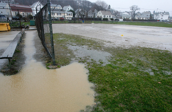 Gloucester: The dugouts at Burnhams field were flooded yesterday afternoon as heavy rain canceled all outdoor sporting events. Photo by Kate Glass/Gloucester Daily Times Monday, April 6, 2009
