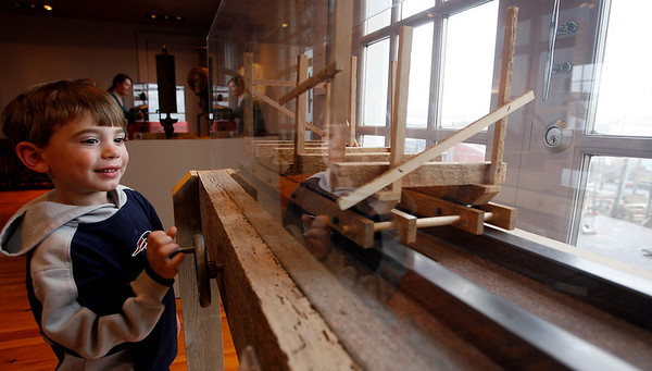 Gloucester: Gus Webster, 3, checks out a model ship railway at the Maritime Heritage Center, which is a replica of the one outside. The center recently completed a renovation, creating more space for hands-on exhibits. Photo by Kate Glass/Gloucester Daily Times Tuesday, April 21, 2009