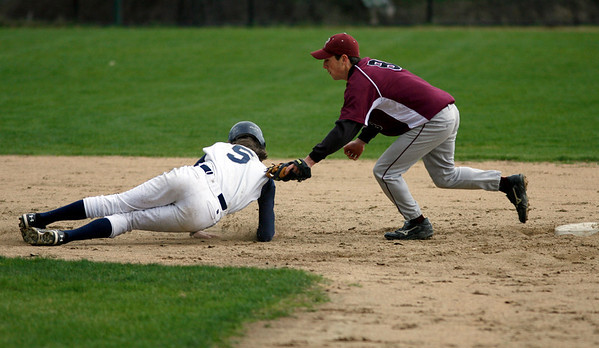 Wenham: Rockport's Pat Frithsen tags Hamilton-Wenham's Pat Twoney as he is caught in a pickle between second and third base during the Vikings' 4-0 loss yesterday. Photo by Kate Glass/Gloucester Daily Times Thursday, April 23, 2009