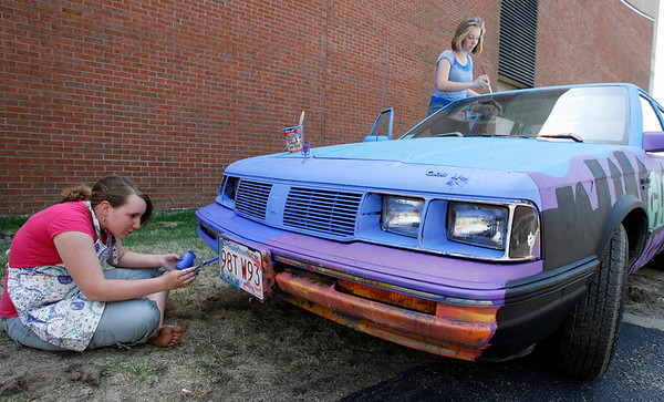 Gloucester: Zoe Paddock, left, and Christine Anderson, both eighth grade students at O'Maley Middle School, paint a car donated by Brenda Malloy to promote the Gloucester Arts Festival, which is May 8-10. The car will be placed in the rotary when it is finished. Photo by Kate Glass/Gloucester Daily Times Tuesday, April 28, 2009