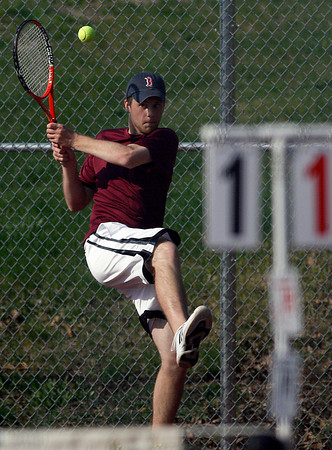 Gloucester: Gloucester's Michael McGovern follows through on a shot during his doubles match against Peabody with teammate Brett Davis (not shown). Photo by Kate Glass/Gloucester Daily Times Monday, April 27, 2009