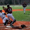 Gloucester: Gloucester catcher Lucas DaSilva tags home plate to get St. John's Prep's Michael Yastrzemski out on a force play during the first inning of their season opener in Danvers yesterday. Photo Kate Glass/Gloucester Daily Times Wednesday, April 8, 2009
