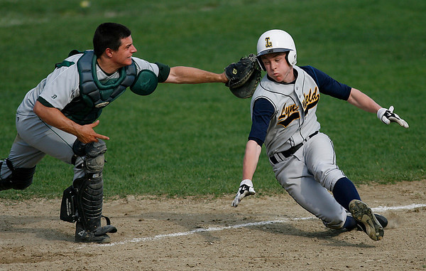 Essex: Manchester Essex catcher Ben Kekeisen just misses Lynnfield's Pete Franchi as he slides into home plate yesterday afternoon. Photo by Kate Glass/Gloucester Daily Times Tuesday, April 28, 2009