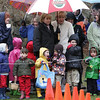 Rockport: Kids and parents wait for the egg hunt to begin at Millbrook Meadow Saturday afternoon.  Dressed in warm coats and rubber boots the kids didn't seem to mind the cold, rainy weather and had fun collecting eggs and meeting the Easter Bunny. Mary Muckenhoupt/Gloucester Daily Times
