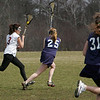 Gloucester: Gloucester's Miha Watanabe, left, runs the ball down the field alongside Triton defenders during the girls lacrosse game at Magnolia Woods Friday afternoon.    Mary Muckenhoupt/Gloucester Daily Times