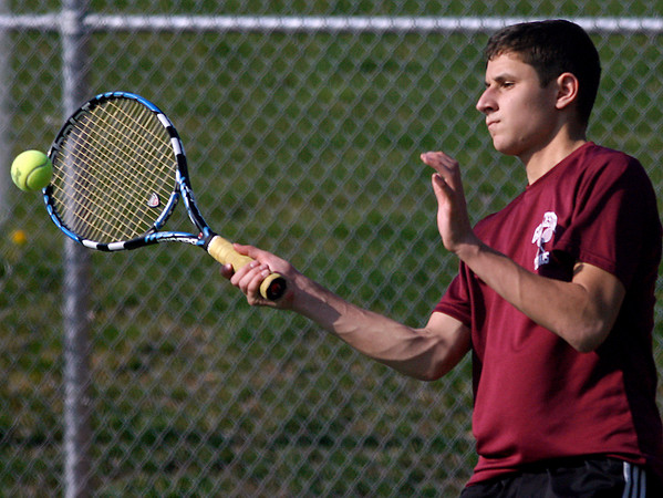 Gloucester: Gloucester's Brett Davis returns a serve during his doubles match against Peabody with teammate Michael McGovern (not shown). Photo by Kate Glass/Gloucester Daily Times Monday, April 27, 2009