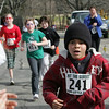 Manchester:  Aisea Richards, 9, crosses the finish line after running the Hit the Street for Little Feet Road Race Saturday morning at Manchester Memorial Elementary School. The race was one mile and a 5k race was held after for more serious runners. Mary Muckenhoupt/Gloucester Daily Times