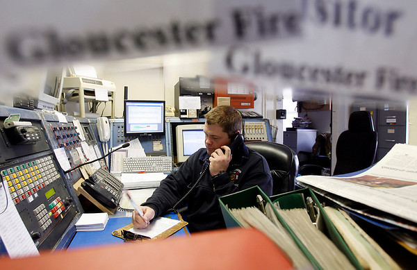 Gloucester: Gloucester Firefighter/Paramedic Jeff Pool takes a call at Central Station yesterday afternoon. Retirements and budget issues have ressurected a series of problems for the department, whose contracted staffing mandates forced the shutdown of all three satellite stations and the dropping of ambulance service at one point this weekend. Photo by Kate Glass/Gloucester Daily Times Tuesday, April 7, 2009