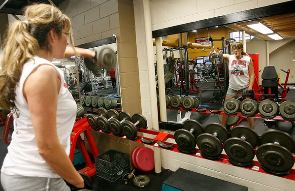 Gloucester: Sandy Gendreau of Gloucester lifts weights at Fitness Zone in the Blackburn Industrial Park. Gendreau has been a member of Fitness Zone for over a year. Photo by Kate Glass/Gloucester Daily Times