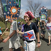 Gloucester: Leslie Milne heads down Hough Avenue as she starts Pride Stride, a five mile walk to raise money for Gloucester Non-Profit, Sunday afternoon.  Leslie and her friends, including David Sidon, left, and Mary Beth Pereira, right, were walking for LEAP, Lanesville Emergency Action Program. Mary Muckenhoupt/Gloucester Daily Times. Mary Muckenhoupt/Gloucester Daily Times
