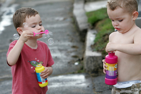 Gloucester: Nikolas Karvelas, 4, blows bubbles with his cousin Christopher, 3, on Beacon Street while enjoying the last few hours of summer weather Sunday afternoon.  Mary Muckenhoupt/Gloucester Daily Times