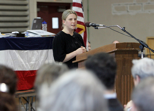 Rockport: Selectman Sarah Wilkinson addresses those in attendance during Rockport Town Meeting held in the gymnasium of Rockport High School Saturday. Mary Muckenhoupt/Gloucester Daily Times