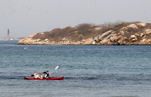 Gloucester: Two kayakers paddle off Good Harbor beach on Tuesday afternoon. Photo by Kate Glass/Gloucester Daily Times Tuesday, April 28, 2009
