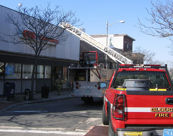 Gloucester: Gloucester Firefighters investigate the scene of a small fire in the CVS building on Main Street yesterday morning, which closed down the street for over an hour. Photo by Richard Gaines/Gloucester Daily Times Tuesday, April 28, 2009
