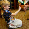 Manchester: Maxwell Kirk, 5, pats a rooster during a Chickens to Eggs program at the Manchester Public Library yesterday morning. Kids got to see a rooster, chicken, and a variety of bird eggs during the program, which was put on by the Mass Audubon Society. Photo by Kate Glass/Gloucester Daily Times Wednesday, April 22, 2009
