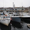 The three draggers -- Lady Elaine, Alyssa & Andrew, and Special K -- resting peacefully on their Pigeon Cove Harbor moorings. Photo by Peter K. Prybot/Gloucester Daily Times