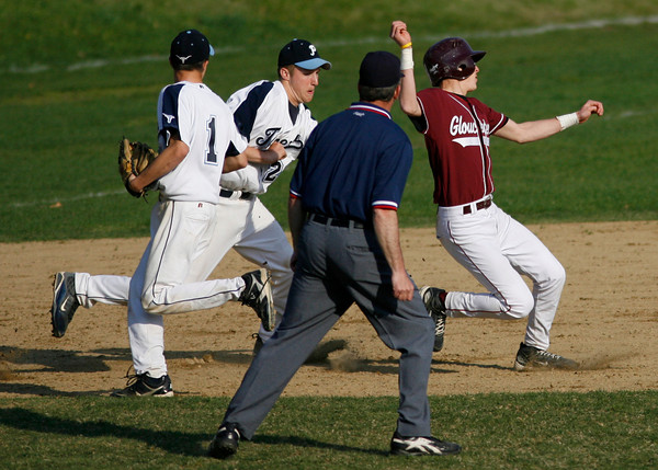 Gloucester's Frank Taormina is chased down by Peabody's Jared Shields as Jim Leavitt looks on during the Fishermen's 6-2 loss to the Tanners yesterday. Photo by Kate Glass/Gloucester Daily Times Monday, April 27, 2009