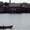 Gloucester: A woman rows past the Paint Factory in Gloucester Harbor Wednesday morning. Photo by Kate Glass/Gloucester Daily Times Wednesday, April 22, 2009