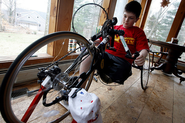 Essex: Brendan Driscoll of Essex, who was born with an underdeveloped tibia that required amputation, skis at Mount Sunapee using the aid of specially equipped poles. Driscoll recently broke his amputated leg, which may force him to bike in the Boston Marthon's 5K instead of running on a prosthetic. Photo by Kate Glass/Gloucester Daily Times Thursday, April 2, 2009
