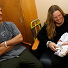 Gloucester: Jonathan and Jennifer Lovelace of Gloucester smile as their daughter, Marin, yawns at Beverly Hospital. Marin was born in the car as they were driving down Route 128. Photo by Kate Glass/Gloucester Daily Times Monday, April 20, 2009