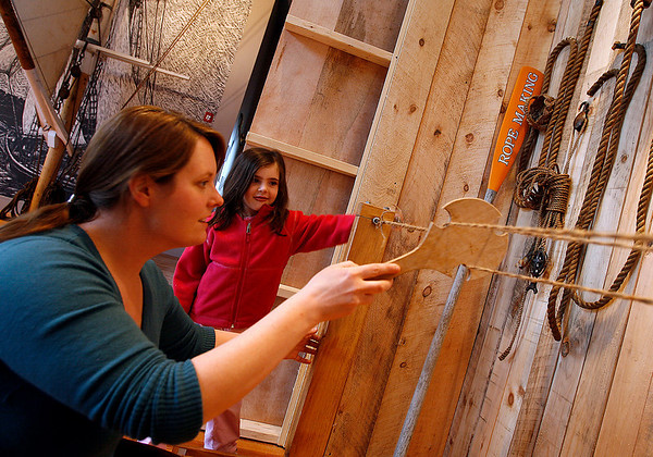 Gloucester: Mary Kay Taylor, Education Coordinator at the Maritime Heritage Center, teaches Molly Webster, 5, how to spin rope. The center recently completed a renovation, creating more space for hands-on exhibits. Photo by Kate Glass/Gloucester Daily Times Tuesday, April 21, 2009