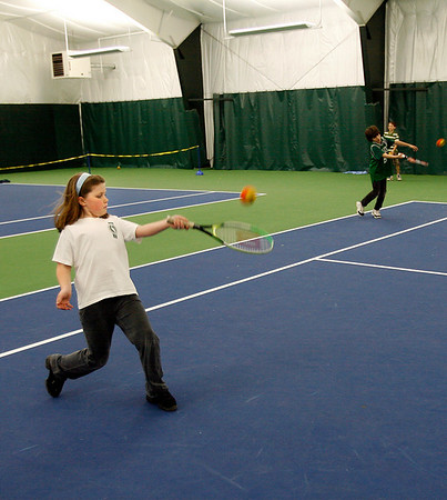 Manchester: Michaela Burke plays tennis at the Manchester Athletic Club as part of their Enrichment program, which includes tennis, excercise, nutrition and science classes. Twelve area schools are participating in the program. Photo by Kate Glass/Gloucester Daily Times Wednesday, April 8, 2009.