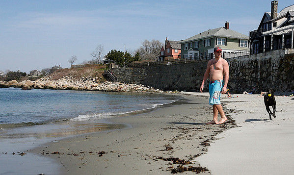 Rockport: Jared Jammal plays catch with his dog, Gunner, at Old Garden Beach yesterday afternoon. It was Gunner's first time at the beach and he did not like the water, which is still very cold. Photo by Kate Glass/Gloucester Daily Times Tuesday, April 28, 2009