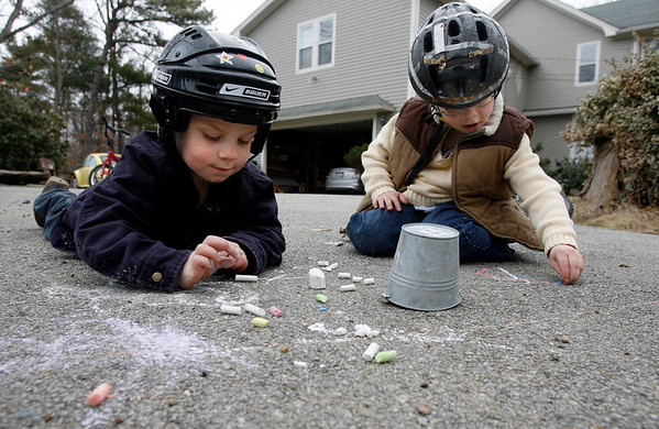 Rockport: Neil Mueller, 3, left, and his brother, Eli, 5, draw pictures on their driveway with chalk on Wednesday afternoon. The two had been riding their bikes earlier.  Photo by Kate Glass/Gloucester Daily Times Thursday, April 1, 2009