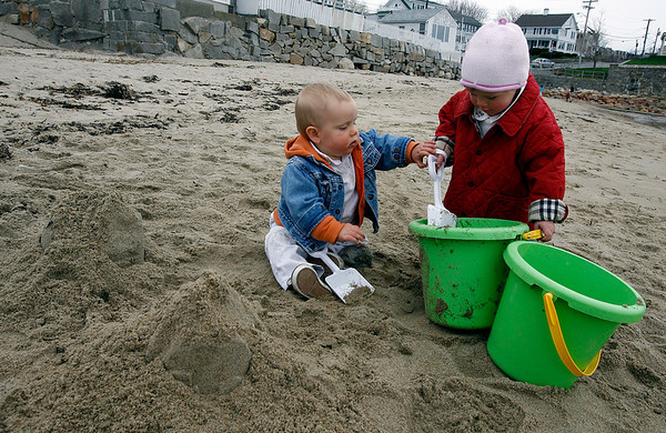Rockport: John O'Connell, 10 months, helps Catherine Catching, 15 months, build a sand castle at Front Beach on Wednesday afternoon. Two minutes later, John knocked over all the sand. Photo by Kate Glass/Gloucester Daily Times Wednesday, April 22, 2009