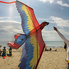 "Manchester: Margo Malupin tries to get control of her parrot kite while enjoying a beautiful beach day at Singing beach Sunday morning.  ""Beach season has begun,"" Malupin said who came to the beach with her husband and twin boys, left. Mary Muckenhoupt/Gloucester Daily Times"